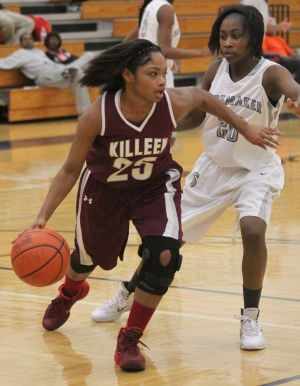 All-Area Girls First Team: Killeen's Tia Harston drives against Shoemaker. - Herald/CATRINA RAWSON