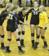 Lady Hornets roll past University in volleyball season debut