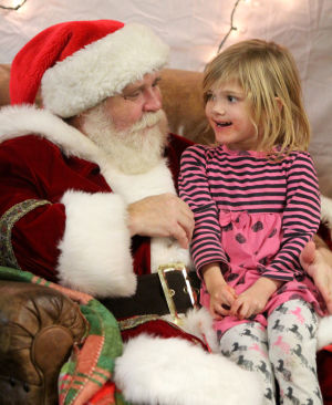 Copperas Cove Boy Scout Christmas Party: Ayla Harrell, 5, speaks with Santa while taking part in her brother's annual Boy Scouts of Leon Valley District Christmas party, Wednesday, December 18, 2013 at Copperas Cove Veterans of Foreign Wars Building. - Photo by Herald/CATRINA RAWSON