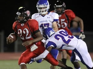 Heights hurt by costly turnovers, Wildcats' effective ground game