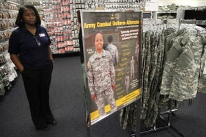 Army Combat Uniform Alternate: Tammer Tracey, store manager, points to the Army Combat Uniform Alternate versions Wednesday morning at the Military Clothing Store on Fort Hood. - Photo by Herald/MARIANNE LIJEWSKI