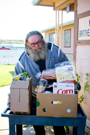 My Brother's House Food Pantry: Clyde Henry of Kempner receives a box of food from My Brother's House food pantry Tuesday, Nov. 19, 2013. - Jodi Perry