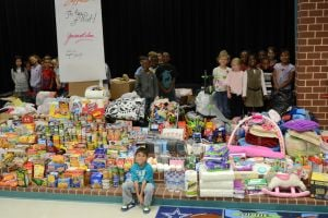 <p>First-graders pose with some of the donations that Haynes Elementary School in Killeen collected Thursday and Friday to aid victims of last week's factory explosion in West. A first-grader inspired the spontaneous collection efforts.</p>