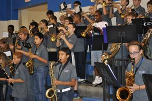 <p>Members of Cove's S.C. Lee Junior High Band play at a recently pep rally. Members of the S.C. Lee band and junior high band members from 15 schools will converge on Copperas Cove for an afternoon-long concert by three bands and 176 musicians.</p>