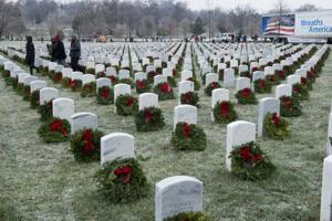 <p>Wreaths rest on headstones in Arlington National Cemetery during the Wreath Across America event, Dec. 17, 2016, in Arlington, Va. This year marks the 25th year that wreaths have been placed at ANC. (Photo Credit: Rachel Larue)</p>