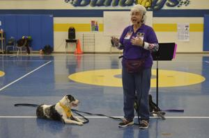 Therapy dog team inspires students to work hard, set goals