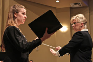 Magnificat: Julia Brown, a student at the University of Mary Hardin-Baylor in Belton, performs a soprano solo at Manning Chapel; Michelle Roueche, conducts the chorus and orchestra. - Photo by Steve Pettit | Herald