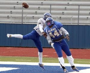 Copperas Cove Practice: Copperas Cove players JD Post, left, and Shaq Fluelen go for the ball during practice Thursday at the Bulldawg Stadium. - Jaime Villanueva