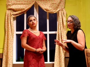 Killeen High School Murder Mystery Production: Courtney Benitez who plays the part of Mildred speaks with Sara Drussell who plays the part of Joan during the production of