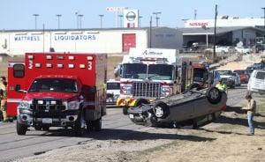 Vehicle Rolls Over Near Martin Luther King Jr. Boulevard Intersection: A vehicle rests on its roof after hitting a concrete barrier in the construction zone near the intersection of Martin Luther King Jr. Boulevard and Stonetree Drive on Wednesday morning in Killeen. - Herald/MARIANNE GISH