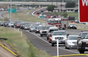 Truck Fire: Traffic backs up after an 18-wheeler that caught fire Monday afternoon on eastbound U.S. Highway 190 near Fort Hood Street in Killeen. - Herald/MARIANNE LIJEWSKI