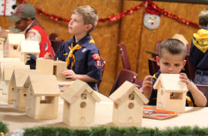 United Way - Boy Scouts: Ben Priester, 8, participates in a birdhouse Christmas decoration activity during the annual Boy Scouts of Leon Valley District Christmas party Wednesday, Dec. 18, 2013, at Copperas Cove Veterans of Foreign Wars building. - Photo by Herald/CATRINA RAWSON