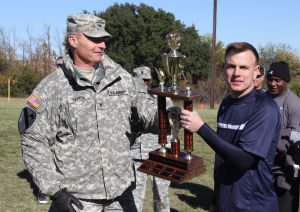 Holiday Bowl: Col. Jeff Harris presents the Holiday Bowl trophy to Maj. Erik Summers on Nov. 27 at Fort Hood. - Jaime Villanueva | Herald