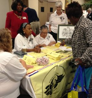 Retiree Day: Members of the local chapter of the Women's Army Corps Veterans Association meet with military retirees and their families during the 39th annual Retiree Day on Saturday at Fort Hood.
