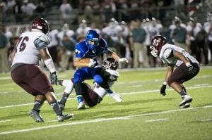 <p>Copperas Cove's Tre Powell is surrounded by A&M Consolidated defenders on Friday night at Bulldawg Stadium in Copperas Cove. Cove won 62-38.</p>