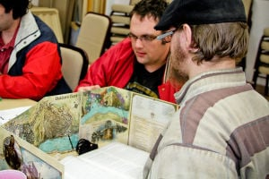 Gaming Session: Eric Huls, right, takes on the roll of