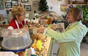 Heidi's German Bakery: Margit Spriggs, left, and customer Beverly Metcalf at Heidi's German Bakery in Town Square Center in Copperas Cove. - Steve Pettit | Herald