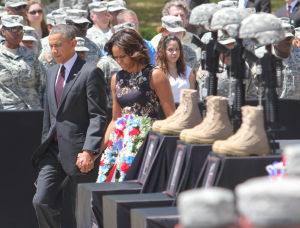<p>President Barack Obama and first lady Michelle Obama arrive at Wednesday's memorial service for the April 2 shooting victims at Fort Hood.</p>