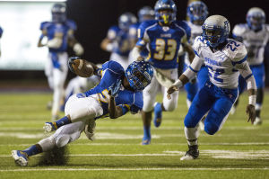 Temple At Copperas Cove: Copperas Cove's JD Post, left, loses his footing while running against Temple's Chris Terry on Friday at Bulldawg Stadium in Copperas Cove. Temple won 51-39, its first win over the Bulldawgs in 10 years, and clinched a playoff berth. - Michael Miller | FME News Service