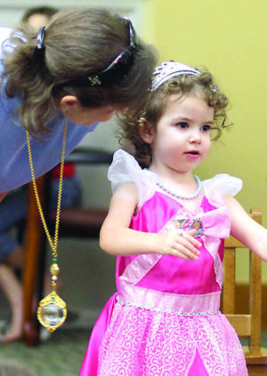 Family Fun Party: Catherine Gensert, 2, tells Library Director Lisa Youngblood what her favourite book is during the Family Fun Party event in honor of Children's Book Week, Thursday evening at the Stewart C. Meyer Library in Harker Heights. - Jaime Villanueva | Herald