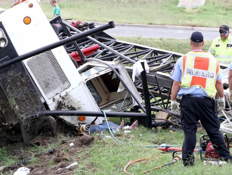 Overturned crane truck