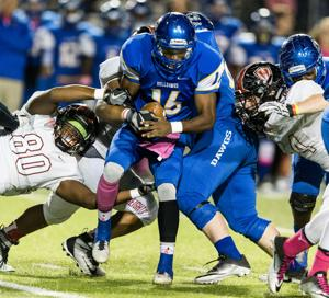 <p>Copperas Cove's Kylan Herrera (16) tries to get through Harker Heights' defensive front on Friday at Bulldawg Stadium.</p>