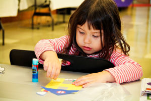 Early Literacy Fair: Alaina Ross (3) does a craft during the Early Literacy Fair held at the Stewart C. Meyer Library on Wednesday morning. - Jodi Perry | Herald