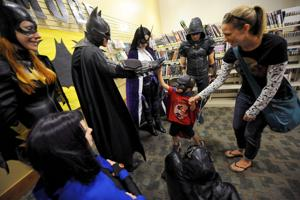 Kids, adults channel inner heroes at Library's 'Batman Day'