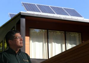 SOLAR PANELS: Mouli Vaidhyanathan, President of Mouli Engineering, stands in front of a home in St. Paul, Minnesota, where the homeowner had installed two of his company's SolarPod panels. - Joel Koyama | Minneapolis Star Tribune