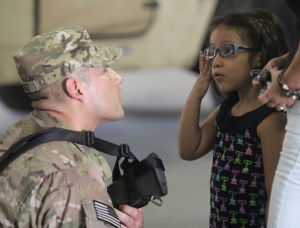 15th Finance Battalion Deployment: Spc. Marco Juarez,  15th Finance Management Support Unit, 4th Special Troops Battalion, 4th Sustainment Brigade, 13th Sustainment Command, says goodbye to his daughter, April, 4, during his deployment ceremony Sept. 25 at Fort Hood. - Herald/CATRINA RAWSON