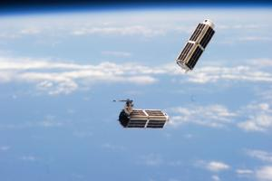 <p>A set of NanoRacks CubeSats is photographed by an Expedition 38 crew member after the deployment by the Small Satellite Orbital Deployer. The CubeSats program contains a variety of experiments such as Earth observations and advanced electronics testing.</p>