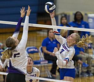 <p>FOR SPORTS - Temple's Jessica Vaden, right, goes for a kill over Florence's Sierra Murphy during game action at Temple High School on Wednesday, Aug. 17, 2016. Michael Miller/Telegram</p>