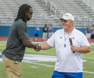 <p>NFL star and former Bulldawg Charles Tillman is introduced by Copperas Cove coach Jack Welch before the Copperas Cove Spring Game at Bulldawg Stadium on May 26.</p>