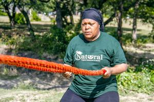 <p>Luvina Sabree works out with ropes and members of MWP Fitness and Nutrition at Purser Park in Harker Heights as part of her new fitness routine.</p>