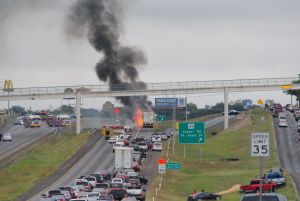 Highway 190 Fire: Traffic is backed up on U.S. Highway 190 Monday as firefighters battle a vehicle fire. An 18-wheeler caught fire, causing the highway to shut down in both directions. - Photo by Courtesy Photo/Jim Parks