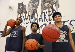 Shoemaker Boys Basketball Seniors: Seniors' Nykolas Dawson, left, Patrick Mark, middle, and Shane Johnson, right, stand in the gym after practice Thursday afternoon at Shoemaker High School. - Herald/MARIANNE GISH