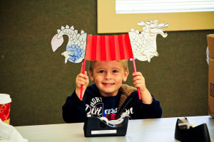 Early Literacy Fair: Hunter Grover (3) of Harker Heights, shows off a craft that he did during the Early Literacy Fair at the Stewart C. Meyer Library on Wednesday morning in honor of Children's Book Week. - Jodi Perry | Herald