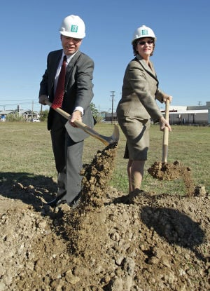 Scott & White Groundbreaking In Cove: Drs. Raymond and Karen Harrison break ground Wednesday, Oct. 23, 2013, during a ceremony at the construction site, signaling the start of a new Scott & White clinic building in Copperas Cove. - Photo by Herald/Jaime Villanueva