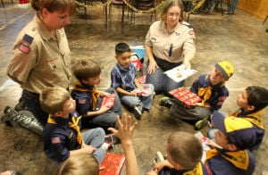 Copperas Cove Boy Scout Christmas Party: Boy Scouts take part in a book exchange during the annual Boy Scouts of Leon Valley District Christmas party , Wednesday, December 18, 2013 at Copperas Cove Veterans of Foreign Wars Building. - Photo by Herald/CATRINA RAWSON