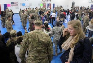 59th Mobility Augmentation Company Homecoming: Friends and family of soldiers from the 59th Mobility Augmentation Company, 8th Engineer Battalion, 36th Engineer Brigade, cheer during their homecoming ceremony, Monday, November 25, 2013 at the Bronco Youth Center at Fort Hood. - Photo by Herald/CATRINA RAWSON