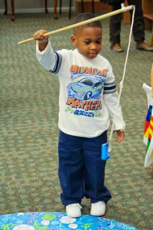 Early Literacy Fair: Deandre Williams (3) fishes for letters during the Early Literacy Fair held at the Stewart C. Meyer Library on Wednesday morning. - Jodi Perry | Herald