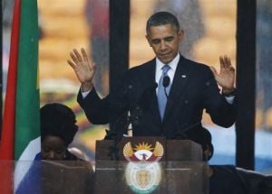 <p>President Barrack Obama acknowledges applause before speaking at the memorial service for former South African President Nelson Mandela at  First National Bank Stadium in Soweto near Johannesburg, Tuesday, Dec. 10, 2013.</p>