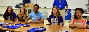 Cove cheerleaders sign with colleges