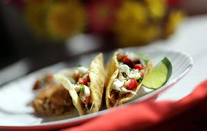 Perk up leftover pork. Turn it into tacos with pico de gallo