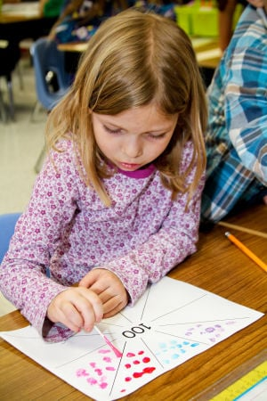 100Days (5): House Creek Elementary first-grader Miley Glick, 6, works on a project during the 100th day of schoolTuesday, Feb. 4, 2014. - Jodi Perry | Herald