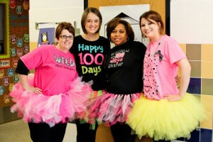 100Days (1): From left, kindergarten teachers Lisa Kumpf, Jill Price, Tonya Sweeney, and student teacher Jennifer Maples dressed in special shirts and tutus for the 100th day of school celebration Tuesday  at House Creek Elementary School. - Jodi Perry