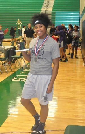 Shoemaker Wrestler Maya Little: Shoemaker senior wrestler Maya Little displays her runner-up trophy and silver medal from the Clear Falls Arm Bar Invitational tournament last weekend. - Courtesy photo