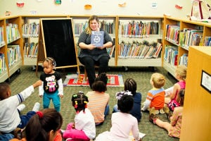 Early Literacy Fair: Harker Heights Children's librarian, Amanda Hairston, reads a story during the Early Literacy Fair held at the Stewart C. Meyer Library on November 20th. - Jodi Perry | Herald