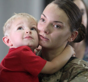 15th Finance Battalion Deployment: Spc. April Suggs, 15th Finance Management Support Unit, 4th Special Troops Battalion, 4th Sustainment Brigade, 13th Sustainment Command, hugs her son, Jayden, 2, before her deployment Sept. 25. - Herald/CATRINA RAWSON