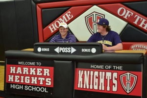 <p>Harker Heights' Logan Fox, left, and Kyle Key sign their letters of intent with Hardin-Simmons University.</p>